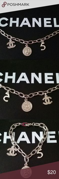 Iconic Couture Bracelet Hand applied charms to a fashionable silver tone cable chain.  Double sided Chanel charm has Coco face and the word CHANEL, the other side has Coco Mademoiselle and the iconic double C. The double C crystal charm has one crystal missing and a #5 charm. Jewelry Bracelets