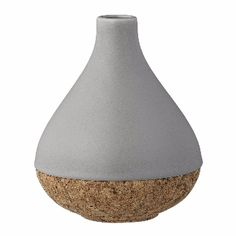 Bloomingville Grey Vase With Cork Base: A beautifuly proportioned grey and cork vase by Bloomingville. An inspired use of different texture and colour have created a truly exceptional vase.