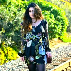 Floral Romper A chiffon material floral romper that features a zipper in the back Forever 21 Pants Jumpsuits & Rompers