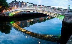 Waking across the Ha'penny Bridge, over the River Liffey, on a summer evening in Dublin, Ireland.