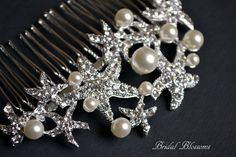This is a gorgeous rhinestone and pearl embellished hair comb perfect for that special day. Wear it by itself in your hair or can be used as