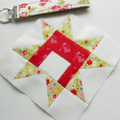Farmer's Wife 1930s block no. 24 - Coral.  A simple patchwork star gets an unbalanced look for the Farmer's Wife collection. As such it doesn't fit well with the rest of the blocks which are nearly all symmetrical.