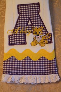 Personalized and appliqued burp cloth baby boys and girls with Tiger in Purple and Gold. $16.00, via Etsy.