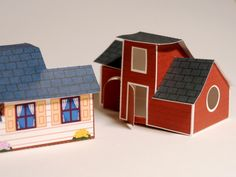Free printable pdf for a white cottage and red cottage. {mmm, make a diorama or pretend play?}