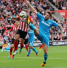 Sunderland striker Connor Wickham at full stretch to reach the ball while Nathaniel Clyne ...