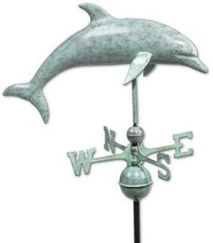 The Good Directions Dolphin Weathervane features a beautiful, heirloom-quality design with a Blue Verde copper finish that mimics the look of weather-aged metal. Determines wind direction in striking fashion atop your home, garage, cupola, or barn. Beach Cottage Style, Coastal Style, Beach House Decor, Coastal Decor, Quirky Home Decor, Cheap Home Decor, Beach Gifts, Delphine, Beach Themes
