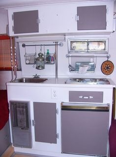 Grey and silver boler interior. I like the hanging rack over the sink.