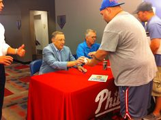 ESPN Broadcaster Brent Musburger signing autographs for fans during Alumni Weekend on Friday, August 10