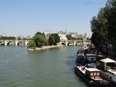 River Seine that surrounds the Ile de la Cite island in the middle, with many boats which are moored up along the bank.  You may be interested in more; www.eutouring.com/images_river_seine.html