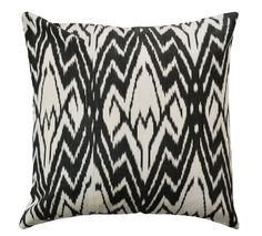 This black and white pillow introduces vintage style, mid-century style to your home.