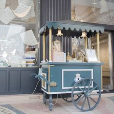 Fancy French Ice cream cart. Cart sits on side walk like its a store.