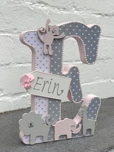 PLEASE NOTE THAT THE PRICE SHOWN IS FOR ONE LETTER ONLY (not the full name) Perfect designs especially for baby nurseries.. baby shower home decor, etc.. Please tell me what you would like and I will be happy to do it for you. These letters are made from MDF wood so will not be