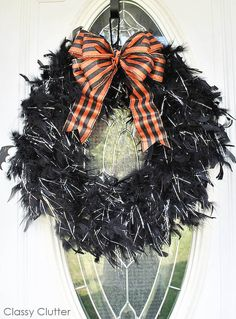 Today I want to show you how to make a super fun and fluffy Halloween wreath! It's super easy and literally took me 5-10 total to make it! You can do it for pretty cheap too! You will need: 2-6ft feather boas Black duct tape A spool of ribbon for your bow if you want one Wreath form or $1 pool noodle First, a took my pool noodle and taped the ends together to create my $1 wreath form. Next, take your black duct tape and wrap it around the whole noodle so you don't see orange peeking through…