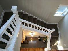 cottage stair well with skylight