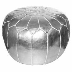 "Handmade leather pouf in silver with a foam fill and decorative stitch detail. Product: PoufConstruction Material: Genuine leather and shredded foam fillColor: SilverFeatures:    Handmade in MoroccoCan be used as an ottoman or extra seating Dimensions: 12"" H x 21"" Diameter"