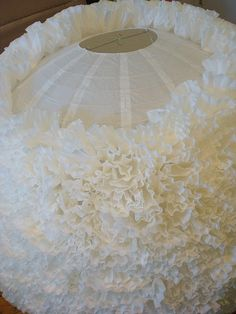 Coffee filter lamp - I've done this with flowers, and this looks just as good but at a FRACTION of the cost!!