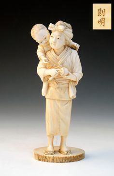 Japanese ivory okimono of a mother peeling an apple for her child (1868 to 1912 Japan)