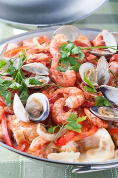 Cataplana is both the name of the meal and the unique Portuguese vessel it's cooked in. This recipe includes fish and seafood cooked slowly to perfection.