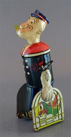 1930s POPEYE WITH PARROT CAGES tin wind-up by Marx by LUNZERLAND., via Flickr