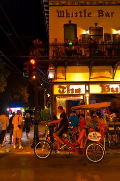 Pedicab passing in front of The Bull & Whistle Bar, Duval Street, Key West, Florida Keys, Florida - Photo by Blaine Harrington III