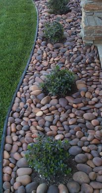 If we need a border somewhere, I like the idea of river rocks like this, or bricks.