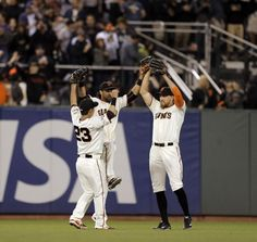 7/27/15 MIL@ SF Giants Aoki, Pagan and Pence celebrate as the Giants defeated the Brewers.