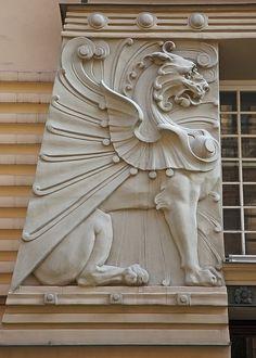 Art Nouveau Griffin (tho it also has elements of Art Deco) in Riga, Latvia. …… Art Nouveau Griffin in Riga, Lettland. … der Architektur in Riga ist Jugendstil, das ist mehr als jede andere Stadt. Motif Art Deco, Art Nouveau Design, Art Nouveau Architecture, Architecture Details, Style Floral, Jugendstil Design, Fu Dog, Elements Of Art, Architectural Elements