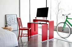 Heckler Design OneLess Desk $749.00  Too bad shipping to Hawaii is so expensive, or I'd have one of these already.