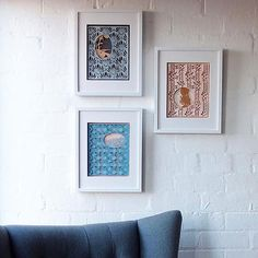 Three different designs of Limited Edition Layered Paper Cuts by Love Hate
