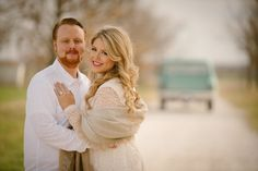 Outdoor engagment photos with bride in white dress and old blue truck in background - Photos by Stephen Karlisch