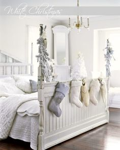 Christmas bedroom decorations; white Christmas stockings hung on the bed