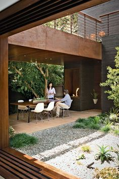 13 Lush, Outdoor Spaces That'll Have You Going Green #refinery29  http://www.refinery29.com/outdoor-spaces-ideas#slide-7  A house designed to be part of the landscape is at home among the trees in Venice, California. The residents often dine on the patio off the kitchen, warmed by a fireplace from Spark Modern Fires. Photo by Coral von Zumwalt. ...