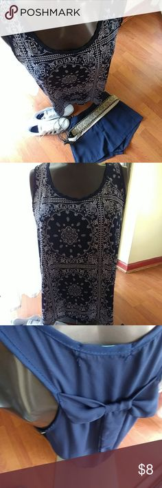 Tank top navy blue short sleeve Beautiful navy and white super boho style, with a cute bow on the back  Perfect condition size Large, but I'm  a medium size and fits perfect, maybe is a junior Large. Tops Tank Tops