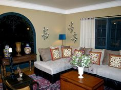 Southwestern Color Palette Decorative wrought iron and a saturated color scheme help spice spice up this hacienda living room.  Design by Angelo Surmelis