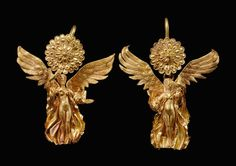 Greek gold earrings with erotes, 4th-3rd century B.C. 4.4 cm long. Private collection