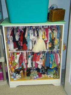 American Girl Clothes Storage - looks like tension rods in an old dresser or bookshelf.