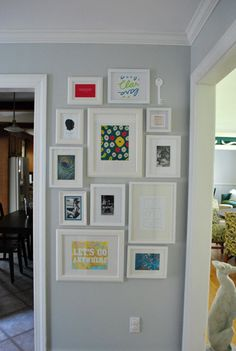 a bit too crowded for me, but nice idea of light gray wall and white frames, colour only inside. Picture frame collage. frame wall