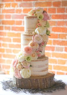 Semi-Naked Wedding Cake, decorated with fresh flowers, set up at Sopley Mill, Dorset. Flowers by @conceptflowers