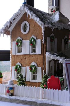 gingerbread house.  I like the fondant used to create the window casing.  Very clean and beautiful!.
