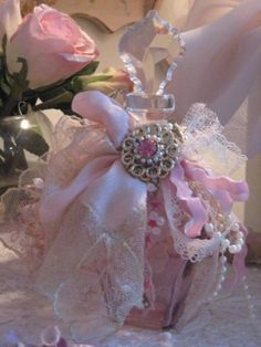 A little lace, some ribbon, a rose and a bottle....all created to have a lovely decoration....