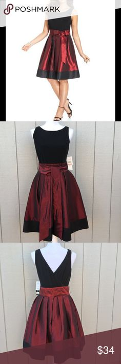 """Red & Black Princess Cut Taffeta Dress Size 10.  MSRP: $109.  Black trim.  Skirt lining with tulle bottom.  V back with tie.  Length from top of shoulder to hem: 38"""".  Bust: 38"""".  Waist: 34"""".  Hips – very forgiving since it's a princess cut.  Shell: 95% polyester, 5% spandex.  Combo/Lining: poly/nylon lining.  Dry clean only.     Love it but not the price - I'm open to (reasonable) offers or consider bundling 2 or more items for an additional 15% off and combined shipping!    Check out my…"""