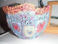 Heart bowl made with water soluble fabric which was heavily machine stitched.