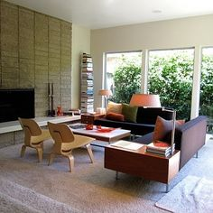 Mid-century modern living room with great warmth and comfort. Looks so inviting!