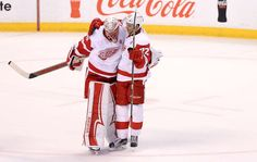 SUNRISE, FL - DECEMBER 23: Jared Coreau #31 and Andreas Athanasiou #72 of the Detroit Red Wings celebrate winning a game in a shootout against the Florida Panthers at BB&T Center on December 23, 2016 in Sunrise, Florida. (Photo by Mike Ehrmann/Getty Images)