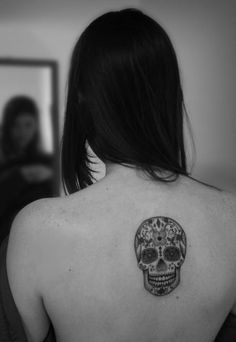 Skull tattoo... I am in no way brave enough to get this, but loves floral skulls!