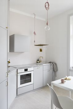 Studio apartment in white, pink and brass
