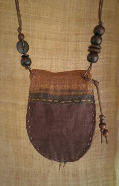A beautifully evocative patchwork talisman pouch. Talisman pouches are normally worn around the neck to carry small precious keepsakes. Slowly and carefully handcrafted using all natural materials :) Made using natural textiles and hand woven hemp. Textile Jewelry, Fabric Jewelry, Talisman, Medicine Bag, Diy Handbag, Boho Bags, Patchwork Bags, Fabric Bags, Leather Design