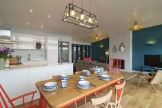 Self-catering eco-chic holiday home 300 metres from the beach in Watergate Bay, North Cornwall with sea views and a large balcony Dining Area, Kitchen Dining, Bay Village, North Cornwall, Catering, England, Table, Furniture, Home Decor