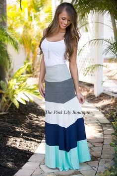 If you can't tell, we love the colorblock style and that's no exception for this cute skirt! With navy, heather grey, charcoal, white, and mint, this skirt is fabulous for relaxed summer gatherings with family and friends!