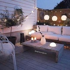 Outdoor living, outdoor style, coach, furniture, porch, outdoor lights, lanterns, table, rope lights, deck, rustic, globe lanters, modern, home decor, diy decor, diy home decor, apartment living, rooftop, outdoors, lights, outdoor cushions, cozy, hangout, outdoor entertainment #afflink #DIYHomeDecorRental